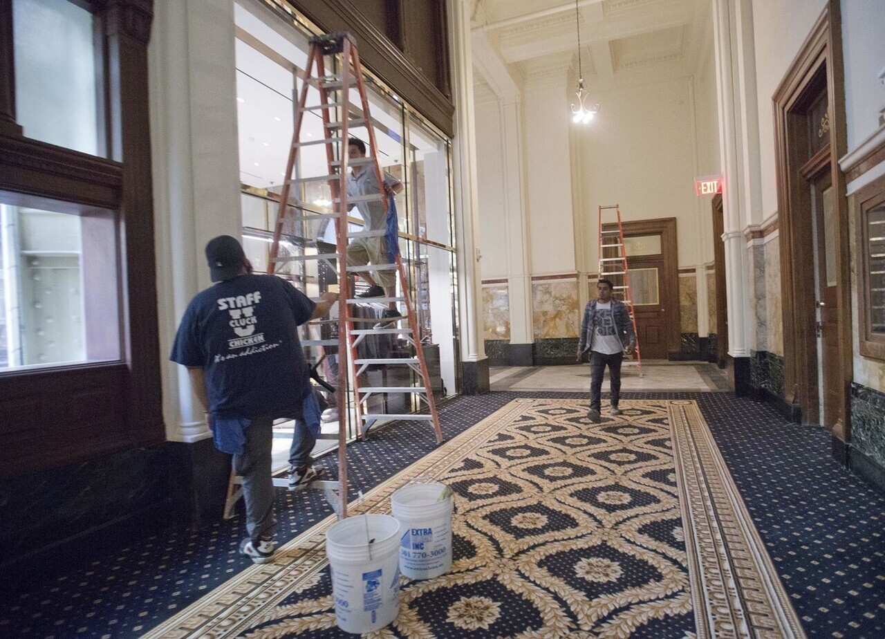 Work continues inside the Trump International Hotel in downtown Washington, Monday, Sept. 12, 2016 in Washington. The luxury hotel Donald Trump has built in an iconic downtown Washington building is set to open. The Trump International Hotel will begin serving guests Monday. There won' class=
