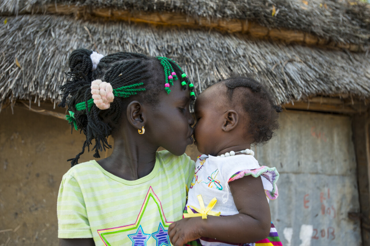 "On 22 October 2015 in South Sudan, (left-right) Nyayjaw, 8, kisses her baby sister Nyagua whom she just met today, after being reunited with her mother. For two years, the family was separated by conflict. Nyayjaw and her brother Chuol, 4, have been living with their elderly grandfather in the Bor Protection of Civilians site. ""I will never allow us to be apart again"", said their mother Nyaruon, after their tearful reunion in Akobo, their hometown. Then came the added joy, the introduction of the children to their newborn baby sister Nyagua whom they have never met before. Over 35,000 South Sudanese children have been separated from their families across the region since conflict broke out in December 2013. This includes over 11,000 children that have been registered as separated, unaccompanied or missing within the country. Multiple displacements, grave child rights violations and increasing food insecurity continue to separate children from their families. UNICEF South Sudan initiated a large scale family tracing and reunification programme, building on new and existing partnerships. By the end of 2015, UNICEF and its partners had been achieved the following: 11,400 children were registered, with family tracing ongoing; over 30  percent of these children were identified by UNICEF staff through direct implementation modalities; 3,600 children were reunited with their families; 12 partnerships were put into place to undertake family tracing and reunification in 29 counties; a national practice framework was put in place, including standard operating procedures and information sharing protocols; a quality framework has been developed to guide partners' efforts to strengthen their responses. UNICEF's Family Tracing and Reunification programme is supported by the European Commission' class="