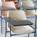 Many lecture chairs arranged neatly in empty classroom.