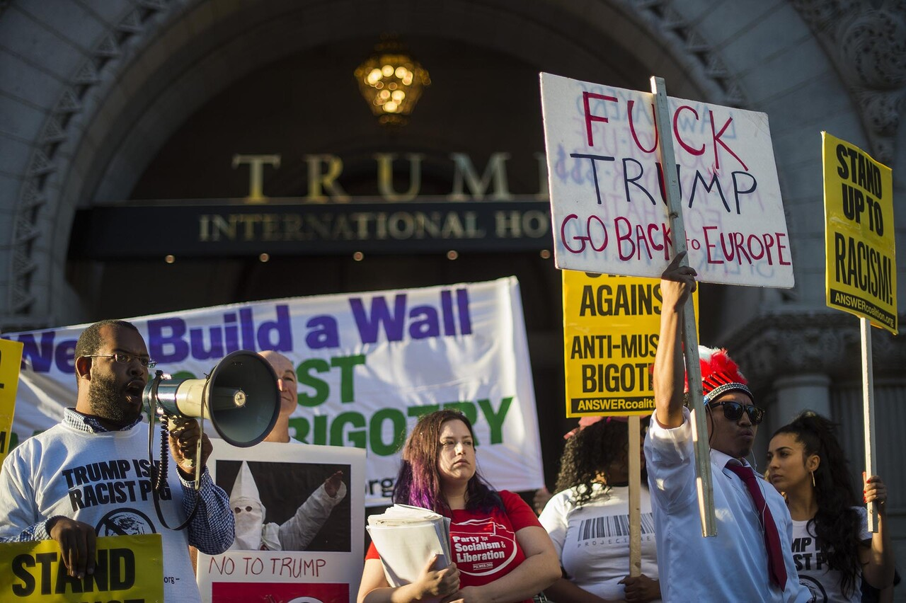 Demonstrators from Answer Coalition protest outside the Trump International Hotel in Washington, DC, September 12, 2016, during the hotel' class=