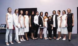 OCTOBER 22: Model prepares backstage at the Indonesia Fashion Forward 2 Show during Jakarta Fashion Week 2017 in Senayan City, Jakarta.