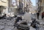 A damaged vehicle is seen after shelling by forces loyal to President Bashar al-Assad in Aleppo's district of Bustan Al Qasr August 7, 2012. REUTERS/Obeida Al Naimi (SYRIA - Tags: CIVIL UNREST MILITARY POLITICS CONFLICT) SYRIA-CRISIS/