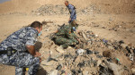 EDITORS NOTE: Graphic content / Member of the Iraqi forces check a mass grave they discovered in the Hamam al-Alil area on November 7, 2016 after they recaptured the area from Islamic State (IS) group jihadists during the ongoing operation to retake Mosul, the last IS-held Iraqi city.   Iraqi investigators carried out an initial examination of a mass grave site discovered in an area south of Mosul that was recently retaken from the Islamic State group.   / AFP PHOTO / AHMAD AL-RUBAYE
