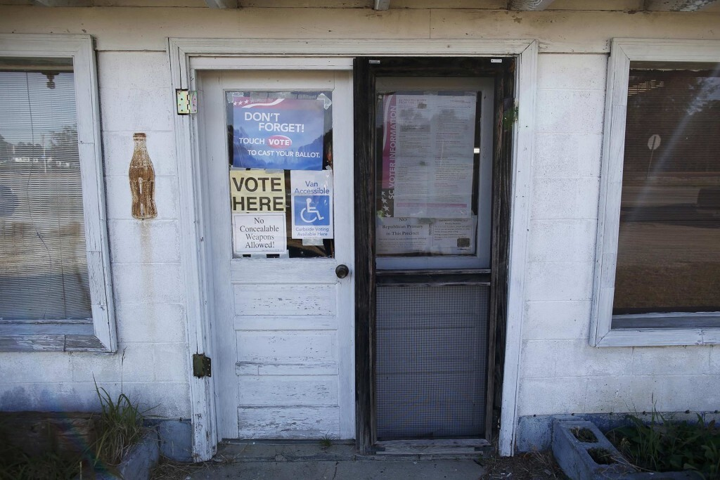 Signs mark the entrance to voters for the Manning precinct polling station at the old Wilkerson Store during the U.S. presidential election in Dillon, South Carolina, U.S. November 8, 2016.  REUTERS/Randall Hill