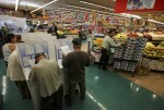 People cast their ballots at a neighborhood grocery store in the 2016 presidential election in National City, California, U.S November 8, 2016.  REUTERS/Mike Blake