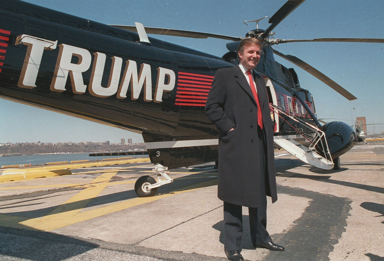 FILE - In this March 1988 file photo, Donald Trump stands next to one of his three Sikorsky helicopters at the New York Port Authority's West 30th Street Heliport in New York. (AP Photo/Wilbur Funches, File)