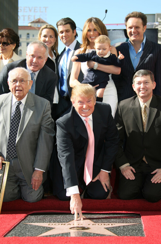 "(FILES) This file photo taken on January 16, 2007 shows US billionaire Donald Trump (C), the producer of NBC's The Apprentice, poses after he was honored by the 2,327th star on the Hollywood Walk of Fame on Hollywood Boulevard in Hollywood, CA. Donald Trump said on November 9, 2016 he would bind the nation's deep wounds and be a president ""for all Americans,"" as he praised his defeated rival Hillary Clinton for her years of public service. / AFP PHOTO / GABRIEL BOUYS"