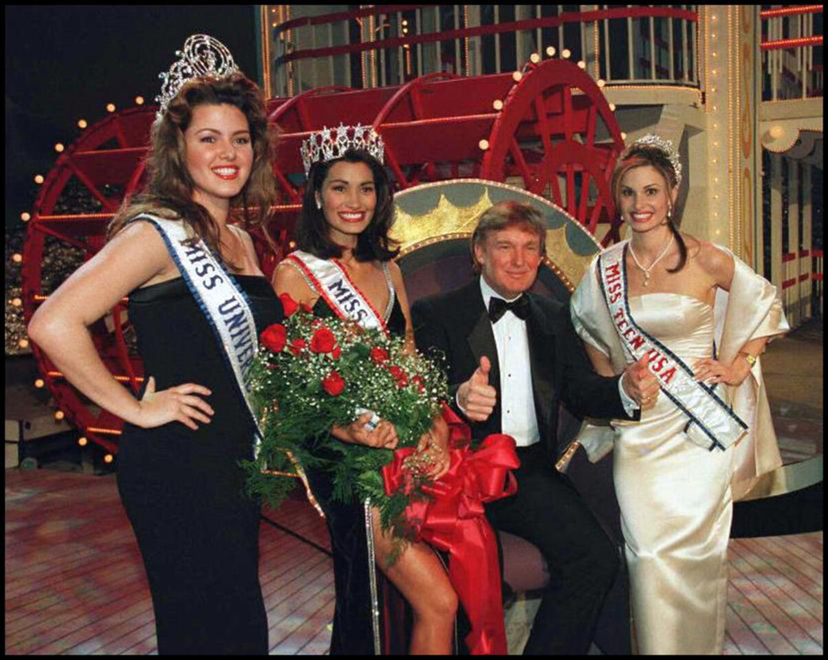 "(FILES) This file photo taken on February 05, 1997 shows Donald Trump, Executive Producer of the 1997 Miss USA Pageant, posing with his titleholders after the new Miss USA was crowned late at the Hirsch Coliseum in Shreveport, Louisana.  Donald Trump said on November 9, 2016 he would bind the nation's deep wounds and be a president ""for all Americans,"" as he praised his defeated rival Hillary Clinton for her years of public service. / AFP PHOTO / MISS USA PAGEANT / Handout"