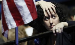 A supporter of Democratic U.S. presidential nominee Hillary Clinton watches results at the election night rally in New York, U.S., November 8, 2016. REUTERS/Rick Wilking