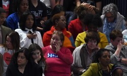 Supporters of Democratic presidential nominee Hillary Clinton look on during election night at the Jacob K. Javits Convention Center in New York on November 8, 2016.  / AFP PHOTO / Jewel SAMAD