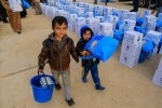 "Ayman (left) and Khalid (right) carry supplies from a distribution point in eastern Mosul.   On 08 December, UNICEF took part in the largest humanitarian aid delivery in eastern Mosul since the current conflict began along with the World Food Programme (WFP), and the United Nations Population Fund (UNFPA). The distribution provided vital emergency food, water and hygiene supplies for 42,000 people - including 21,000 children.   With generous contributions from the US Office of Foreign Disaster Assistance (OFDA) and the Directorate-General for European Civil Protection and Humanitarian Aid Operations (DG ECHO), UNICEF distributed one monthÕs supply of water purification tablets, high energy biscuits, jerry cans, baby hygiene kits and leaflets with information on child protection and mine awareness.  ""Mosul's children have already suffered immensely over the past two years. Many could be forcibly displaced, trapped between fighting lines, or caught in the cross fire,"" said Peter Hawkins, UNICEF Representative in Iraq.  As of late November, almost 70,000 people - including 35,000 children - have been displaced as a result of the ongoing military operation to retake Mosul and surrounding areas. In addition to those who have fled their homes, UNICEF is also providing assistance to families who have stayed in recently re-taken areas.   Between 17 October and 13 November, UNICEF has reached at least 105,983 people affected by Mosul operations with life-saving response items through the Rapid Response Mechanism (RRM) and an additional 54,000 vulnerable people in recently re-taken communities."