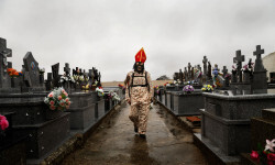 "A member of the Endiablada brotherhood walks trough the cemetery after paying respect to their deceased fellow believers and relatives during the 'Endiablada' traditional festival in Almonacid Del Marquesado, Spain. The ""Endiablada"" (The Brotherhood of the Devils) festivals are celebrated each Feb. 2-3 in the central Spanish town of Almonacid del Marquesado since medieval times or before. (AP Photo/Daniel Ochoa de Olza)"