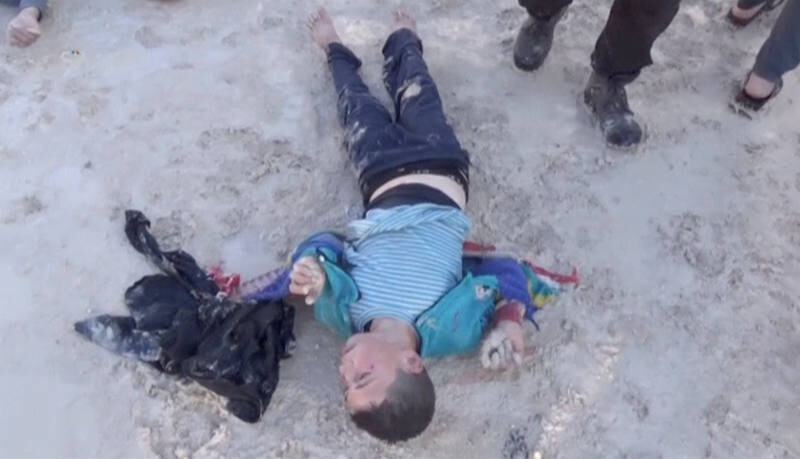 ATTENTION EDITORS - VISUAL COVERAGE OF SCENES OF INJURY OR DEATH A still image taken from a video posted to a social media website on April 4, 2017, shows a boy lying on the ground said to be in the town of Khan Sheikhoun, after what rescue workers described as a suspected gas attack in rebel-held Idlib, Syria. Social Media Website via Reuters TV ATTENTION EDITORS - THIS IMAGE HAS BEEN SUPPLIED BY A THIRD PARTY. IT HAS BEEN CHECKED BY REUTERS' SOCIAL MEDIA TEAM AND REVIEWED BY A SENIOR EDITOR. REUTERS IS CONFIDENT THE EVENTS PORTRAYED ARE GENUINE TEMPLATE OUT