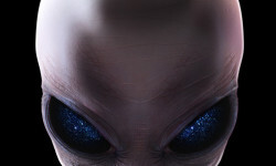 Grey alien with stars in his eyes facing forward isolated on black