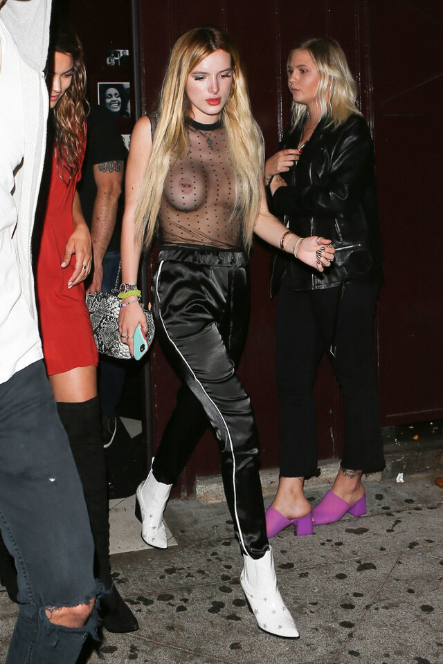 Photo © 2017 Backgrid/The Grosby Group EXCLUSIVE West Hollywood, June 4, 2017. Bella Thorne kicks off the weekend with a bang as she and her friends hit up The Peppermint Club on a night out. Bella goes bra free in nothing but a sheer top and satin track pants as she dashes to their ride. The actress shows off her full and ample cleavage and piercing as she bares all for the world to see. Ever confident, Bella keeps her head high and embraces her risque fashion move to start her weekend off. Shot on 06/02/17.