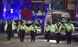 Police officers on Borough High Street as police are dealing with an incident on London Bridge in London  Saturday  June 3  2017     Witnesses reported a vehicle hitting pedestrians and injured people on the ground   Dominic Lipinski PA via AP