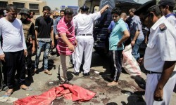 Egyptian policemen inspect the scene of an attack which left five of their colleagues killed in a shooting near Badrasheen, a town some 20 kilometres (12 miles) from Cairo where militants have also targeted security forces in the past, on July 14, 2017. A statement issued by the Interior Ministry said three gunmen opened fire on a police car and then fled, killing a non-commissioned officer, three conscripts and a police employee. / AFP PHOTO / Ahmed ABD EL-GAWAD