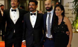 Actor Nicolas Vazquez (L) and soccer players Ezequiel Lavezzi and Javier Mascherano and his wife Fernanda pose for photographers at the wedding of Lionel Messi and Antonela Roccuzzo in Rosario, Argentina, June 30, 2017. REUTERS/Marcos Brindicci