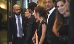Barcelona's football player Javier Mascherano (L) poses with other guests on a red carpet during Argentine football star Lionel Messi and Antonella Roccuzzo's wedding in Rosario, Santa Fe province, Argentina on June 30, 2017.