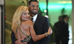 Manchester's United goalkeeper, Argentinian Sergio Romero, poses with his wife on a red carpet during Argentine football star Lionel Messi and Antonella Roccuzzo's wedding in Rosario, Santa Fe province, Argentina on June 30, 2017.