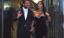 """Chelsea's football player Cesc Fabregas and his wife pose on a red carpet upon arrival to attend Argentine football star Lionel Messi and Antonella Roccuzzo's wedding in Rosario, Santa Fe province, Argentina on June 30, 2017. Footballers and celebrities including pop singer Shakira gathered for the """"wedding of the century"""" in Lionel Messi's Argentine hometown as the Barcelona superstar prepared to marry his childhood sweetheart Antonella Roccuzzo. / AFP PHOTO / EITAN ABRAMOVICH"""