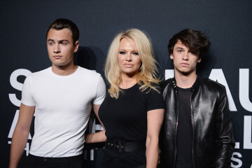 LOS ANGELES, CA - FEBRUARY 10: Actress Pamela Anderson (center) and her sons Brandon Lee (L) and Dylan Lee attend the Saint Laurent show at The Hollywood Palladium on February 10, 2016 in Los Angeles, California.  (Photo by Kevork Djansezian/Getty Images)
