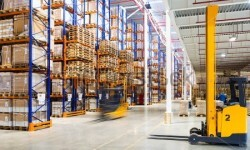 stock-photo-large-modern-warehouse-with-forklifts-396462703-1