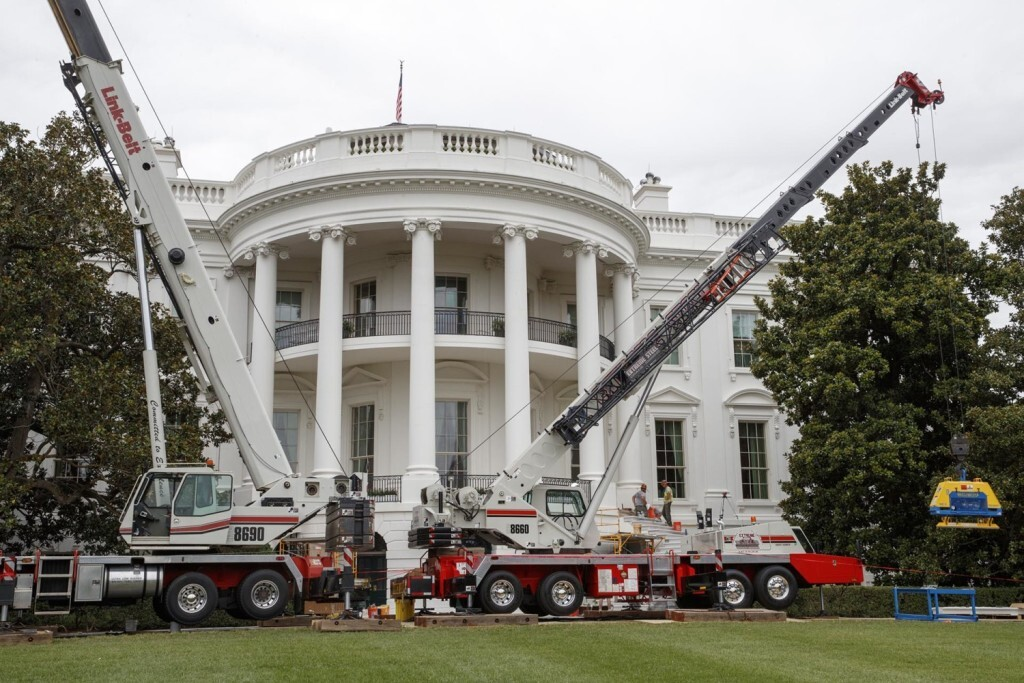 Cranes are positioned in front of the South Portico of the White House in Washington, Friday, Aug. 11, 2017, during renovations while President Donald Trump is spending time at his golf resort in New Jersey. (AP Photo/J. Scott Applewhite)
