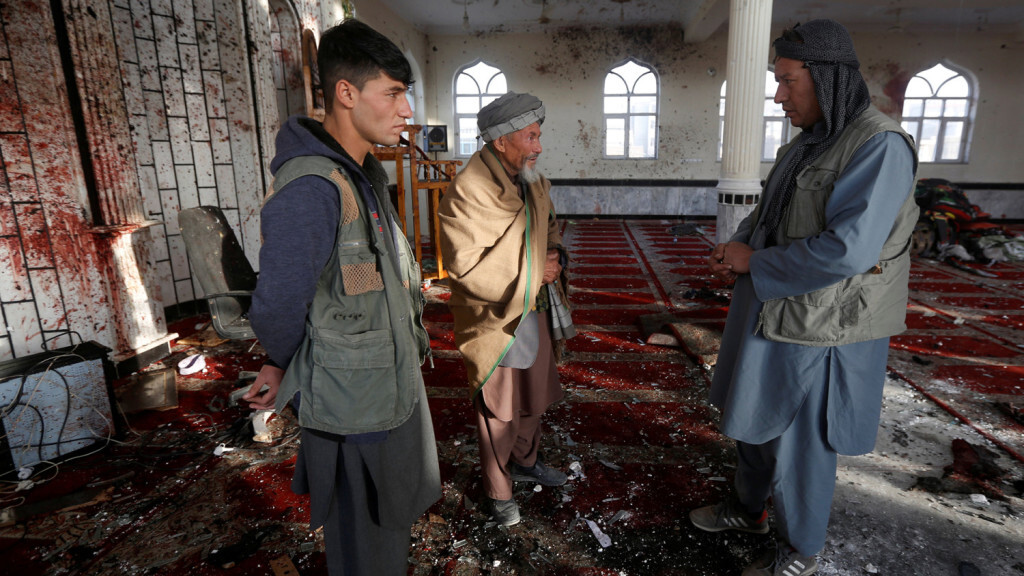 ATTENTION EDITORS - VISUAL COVERAGE OF SCENES OF DEATH AND INJURY Afghan men inspect inside a Shi'ite Muslim mosque after last night attack in Kabul, Afghanistan October 21, 2017.  REUTERS/Omar Sobhani