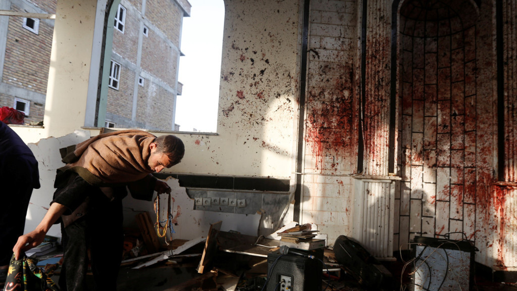 ATTENTION EDITORS - VISUAL COVERAGE OF SCENES OF INJURY OR DEATH  An Afghan man inspects inside a Shi'ite Muslim mosque after last night attack in Kabul, Afghanistan October 21, 2017.  REUTERS/Omar Sobhani   TEMPLATE OUT