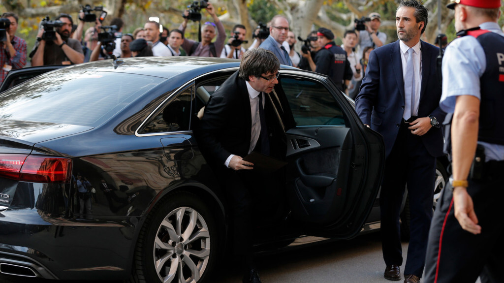 Catalan regional government president Carles Puigdemont arrives to address the Catalan regional parliament in Barcelona on October 10, 2017. Spain's worst political crisis in a generation will come to a head as Catalonia's leader could declare independence from Madrid in a move likely to send shockwaves through Europe. / AFP PHOTO / PAU BARRENA