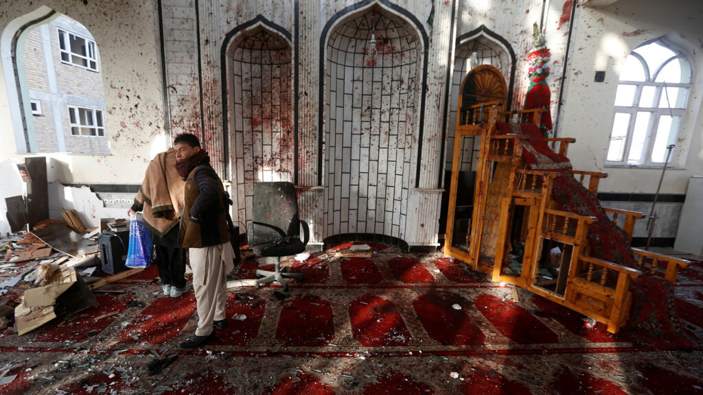 ATTENTION EDITORS - VISUAL COVERAGE OF SCENES OF DEATH AND INJURY Afghan men inspect inside a Shi'ite Muslim mosque after last night's attack in Kabul, Afghanistan October 21, 2017.  REUTERS/Omar Sobhani