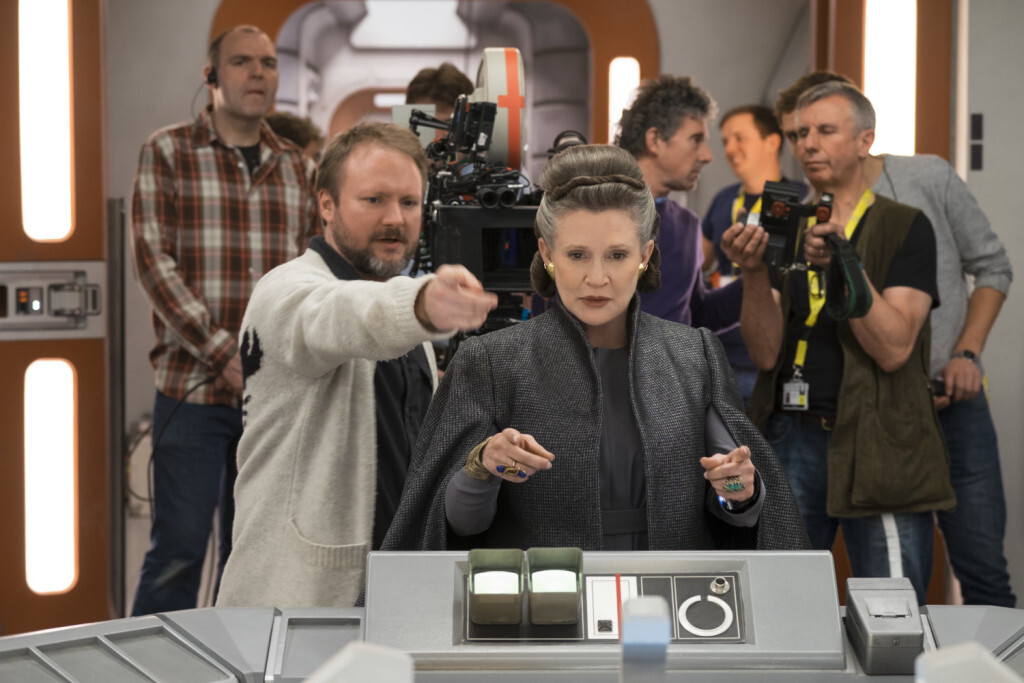 Star Wars: The Last Jedi..L to R: Director Rian Johnson with Carrie Fisher (Leia) on set. ..Photo: David James..©2017 Lucasfilm Ltd. All Rights Reserved.