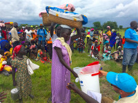 UNICEF staff distribute WASH supplies, including buckets, soap and water purifiers, to pregnant women and lactating mothers, during a Rapid Response Mechanism (RRM) mission in Kaikuiny village, Jonglei State, South Sudan, Friday 25 August 2017.  As of August 2017, the nutrition situation in South Sudan remains critical as the country approaches the end of the lean season. UNICEF and partners are working to treat rising levels of severe malnutrition among children brought on by years of conflict and instability. More than one million children in the country are estimated to be malnourished with over 276,000 suffering from severe acute malnutrition, a life-threatening condition.  Malaria is endemic in South Sudan, where some 50 children under five die from the illness every week. Across the country, UNICEF and partners are working to prevent and treat malaria. Through funding from the European Civil Protection and Humanitarian Aid Operations (ECHO), the UN Foundation and Nothing But Nets, UNICEF, together with its partner the International Medical Corps, have been working on malaria prevention through Child Health Days, which run for several days each time and provide treatment for malaria, as well as nutrition and health services. With Child Health Days, all pregnant women and children under five years of age are given mosquito nets to protect them while they sleep. Those testing positive for malaria are provided with treatment at no charge.   Close to two million children are out of school in South Sudan due to the ongoing violence across the country. More than 30 percent of schools have closed as a result of the conflict. Through partners, UNICEF is working to improve access to education in the country, by training teachers and providing school supplies such as textbooks, teacher's kits, recreational kits and school kits, for the students.