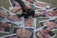 MEXICO CITY, MEXICO - MAY 16: Mexican journalists place portraits of their murdered colleagues during a demonstration to draw attention to the latest wave of killings of journalists at Angel de la Independencia on May 16, 2017 in Mexico City, Mexico. Javier Valdez an award-winning reporter who specialized in covering drug trafficking and organized crime is one of several journalists who have been killed in Mexico in 2017. (Photo by Miguel Tovar/LatinContent/Getty Images)