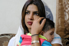 On 10 September 2017, UNICEF Goodwill Ambassador Priyanka Chopra holds 5 year old Suleiman during a visit to his home in Amman, Jordan. While Suleiman was born in Jordan, his parents, a brother and two sisters arrived in Jordan from Syria about 5 years back. He has several health complications but his parents cannot afford to give him proper medical attention.  On Monday, 11 September 2017, UNICEF Goodwill Ambassador Priyanka Chopra wrapped up a two-day visit to Jordan where she met with Syrian children, as well as young people and their families whose lives have been greatly affected by the ongoing conflict. On the first day, Chopra visited a UNICEF supported centre in Jordan's capital Amman, where children can access psychosocial support services, life skills training and informal learning. With thousands of Syrian children out of school, Jordan's Ministry of Education and UNICEF are mobilizing such centres across the country to help girls and boys enrol back in school. On the second day, Chopra visited Za'atari refugee camp, one of the largest Syrian refugee camps in the world with a population of around 80,000 people. In Za'atari, she met with girls at a UNICEF-supported school and at two centres that provide psychosocial support services to young boys involved in child labour and young girls who are married. Although there are currently about 21,000 children enrolled in the 14 school complexes in the camp, enrolment rates stand at 73 per cent, due to child labour and child marriages.  The Syrian refugee crisis remains the largest humanitarian crisis since the end of World War II. Now in its seventh year, over 8 million children inside Syria and in neighbouring countries, including Jordan, need humanitarian assistance. UNICEF is working with partners to provide them with access to clean water, health and nutrition, as well as the education and protection that will help them to grow and thrive.