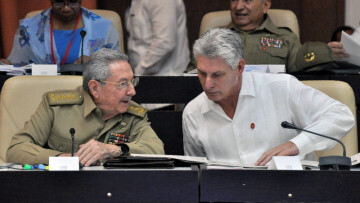 (FILE) Picture taken on July 14, 2017 of Cuban President Raul Castro (L) and First Vice president Miguel Diaz-Canel talking during the Permanent Working Committees of the National Assembly of the People's Power. Cuba is preparing for the end of an era next week when Raul Castro steps down as president, ending his family's six-decade grip on power, and paving the way for a younger leader. But analysts say his replacement, expected to be 57-year-old Miguel Diaz-Canel -- currently Cuba's first vice president -- won't quite be alone at the helm of the communist island. / AFP PHOTO / JORGE BELTRAN / TO GO WITH AFP STORY by Alexandre GROSBOIS