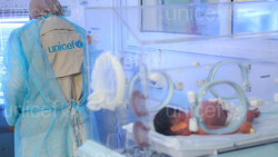 On 8 January 2017, an infant who was born prematurely receives treatment in Alsabeen Hospital, Sana'a, Yemen. A UNICEF staff member (left) visits the hospital.