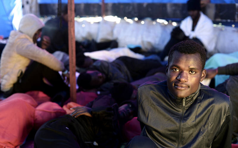 A migrant looks on as he rests on the deck of MV Aquarius, a search and rescue ship run in partnership between SOS Mediterranee and Medecins Sans Frontieres on their way to Spain, June 13, 2018. Karpov / SOS Mediterranee/handout via REUTERS ATTENTION EDITORS - THIS IMAGE WAS PROVIDED BY A THIRD PARTY.