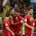 FWC04-23. Sochi (Russian Federation), 15/06/2018.- Cristiano Ronaldo (C) of Portugal celebrates after scoring against Spain during the FIFA World Cup 2018 group A preliminary round soccer match between Portugal and Spain at the Fisht Stadium, in Sochi, Russia, 15 June 2018.   (RESTRICTIONS APPLY: Editorial Use Only, not used in association with any commercial entity - Images must not be used in any form of alert service or push service of any kind including via mobile alert services, downloads to mobile devices or MMS messaging - Images must appear as still images and must not emulate match action video footage - No alteration is made to, and no text or image is superimposed over, any published image which: (a) intentionally obscures or removes a sponsor identification image; or (b) adds or overlays the commercial identification of any third party which is not officially associated with the FIFA World Cup) (España, Mundial de Fútbol, Rusia) EFE/EPA/PAULO NOVAIS EDITORIAL USE ONLY
