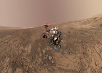 "This NASA photo taken on February 04, 2018, is a self-portrait of NASA's Curiosity Mars rover on Vera Rubin Ridge. Directly behind the rover is Gale Crater's rim.  Behind Curiosity's mast is Mount Sharp. Curiosity landed on Mars five years ago with the intention of studying lower Mount Sharp, where it will remain for all of its time on Mars. The mountain's base provides access to layers formed over millions of years. These layers formed in the presence of water -- likely due to a lake or lakes that sat at the bottom of the mountain, which sits inside Gale Crater. This mosaic was assembled from dozens of images taken by Curiosity's Mars Hands Lens Imager (MAHLI). They were all taken on January 23, 2018, during Sol 1943.  A massive underground lake has been detected for the first time on Mars, marking the largest body of liquid water ever found on the Red Planet, scientists said on July 25, 2018. Located under a layer of Martian ice, the lake is vast, spanning about 12 miles (20 kms) wide, and raises the possibility that more water, and maybe even life exists on Earth's neighboring planet, said the report in the US journal Science.  / AFP PHOTO / NASA/JPL-Caltech/MSSS / Handout / RESTRICTED TO EDITORIAL USE - MANDATORY CREDIT ""AFP PHOTO / NASA/JPL-Caltech/MSSS/HANDOUT"" - NO MARKETING NO ADVERTISING CAMPAIGNS - DISTRIBUTED AS A SERVICE TO CLIENTS"