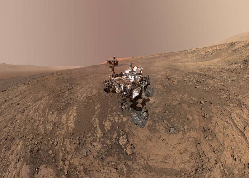 """This NASA photo taken on February 04, 2018, is a self-portrait of NASA's Curiosity Mars rover on Vera Rubin Ridge. Directly behind the rover is Gale Crater's rim.  Behind Curiosity's mast is Mount Sharp. Curiosity landed on Mars five years ago with the intention of studying lower Mount Sharp, where it will remain for all of its time on Mars. The mountain's base provides access to layers formed over millions of years. These layers formed in the presence of water -- likely due to a lake or lakes that sat at the bottom of the mountain, which sits inside Gale Crater. This mosaic was assembled from dozens of images taken by Curiosity's Mars Hands Lens Imager (MAHLI). They were all taken on January 23, 2018, during Sol 1943. A massive underground lake has been detected for the first time on Mars, marking the largest body of liquid water ever found on the Red Planet, scientists said on July 25, 2018. Located under a layer of Martian ice, the lake is vast, spanning about 12 miles (20 kms) wide, and raises the possibility that more water, and maybe even life exists on Earth's neighboring planet, said the report in the US journal Science.  / AFP PHOTO / NASA/JPL-Caltech/MSSS / Handout / RESTRICTED TO EDITORIAL USE - MANDATORY CREDIT """"AFP PHOTO / NASA/JPL-Caltech/MSSS/HANDOUT"""" - NO MARKETING NO ADVERTISING CAMPAIGNS - DISTRIBUTED AS A SERVICE TO CLIENTS"""