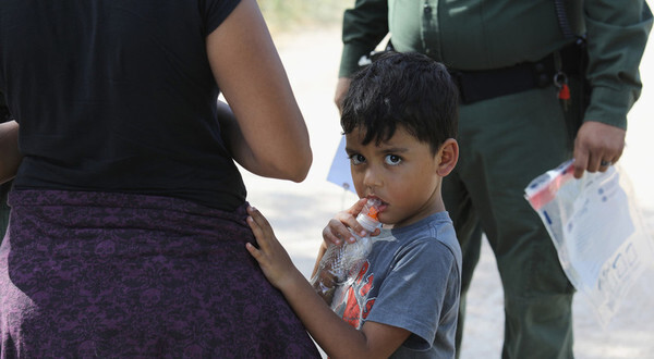 "MCALLEN, TX - JUNE 12:  Central American asylum seekers wait as U.S. Border Patrol agents take them into custody on June 12, 2018 near McAllen, Texas. The families were then sent to a U.S. Customs and Border Protection (CBP) processing center for possible separation. U.S. border authorities are executing the Trump administration's ""zero tolerance"" policy towards undocumented immigrants. U.S. Attorney General Jeff Sessions also said that domestic and gang violence in immigrants' country of origin would no longer qualify them for political asylum status.  (Photo by John Moore/Getty Images)"