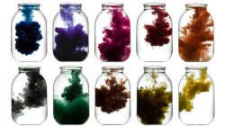 Paint swirling in water. Colorful smoke a glass jar.