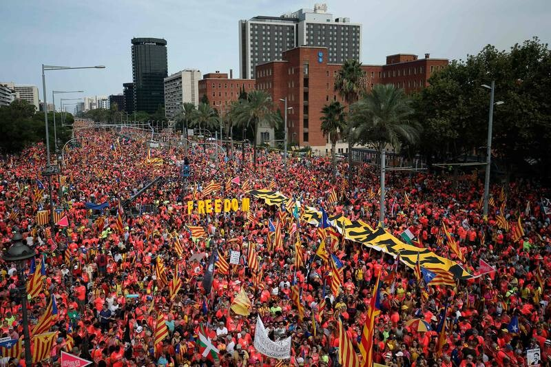 "People wave pro-independence Catalan flags 'Esteladas' while holding letters reading ""Freedom"" during a pro-independence demonstration in Barcelona on September 11, 2018 to mark the National Day of Catalonia, the ""Diada"". - Catalan separatists will seek to put on a show of strength and unity at celebrations of the region's national day today, nearly a year after a failed attempt to break away from Spain. Catalonia's national day, the 'Diada' commemorates the fall of Barcelona in the War of the Spanish Succession in 1714 and the region's subsequent loss of institutions and freedoms. (Photo by Pau Barrena / AFP)"