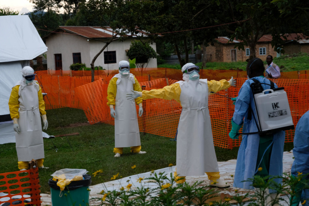 On 14 September 2018, medical workers are thoroughly cleaned after visiting patients at an Ebola treatment centre in Butembo, Democratic Republic of Congo, after a recent outbreak of the deadly disease. Since the Ebola outbreak was declared on 1 August 2018, UNICEF has collaborated with community, youth and religious leaders to reach more than 3.3 million people with Ebola prevention and advocacy messages. UNICEF is expanding its Ebola response and deploying to Butembo a team of 11 specialists in community communication, education, psycho-social assistance, and water, sanitation and hygiene to help contain the disease and avoid any further spread of the epidemic. While expanding its response to the city of Butembo, UNICEF continues to work with its partners in Mangina and Beni. Since the beginning of the outbreak, UNICEF has collaborated with community, youth and religious leaders to reach more than 3.3 million people with Ebola prevention and advocacy messages. UNICEF is working with local communities and Ebola survivors to ensure that the strategies put in place are effective and sustainable, and to defuse local resistance against the Ebola response, especially in the Ndindi neighbourhood of Beni. UNICEF multidisciplinary teams include anthropologists, who ensure that the response is sensitive to cultural believes and practices, particularly around caring for sick and diseased individuals, and addressing populations' concerns about secure and dignified burials. In Ndindi, local committees are working hand-in-hand with UNICEF to identify and implement sensitization activities. Local committees have contributed to the setting up of sensitization trucks with megaphones driving through the neighbourhood.