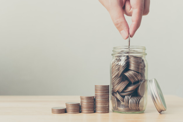 hand-of-male-or-female-putting-coins-in-jar-with-money_20693-58
