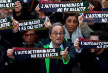 """Catalan Regional President Quim Torra takes part during a rally of Catalan separatist organizations to demonstrate against the trial of Catalan leaders and call for self-determination rights in Barcelona, Spain, February 16, 2019. Banners read """"Self-determination is not a crime"""". REUTERS/Juan Medina"""