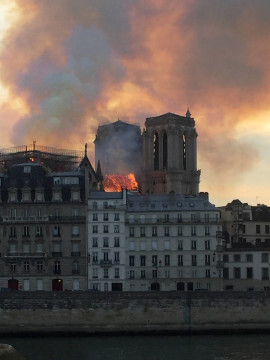Smoke billows from the Notre Dame Cathedral after a fire broke out, in Paris, France, April 15, 2019. REUTERS/Julie Carriat