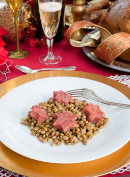 Pig trotter star shaped with lentils over christmas table.